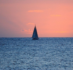 Lone Sailboat at Dusk by Daniel Ramirez