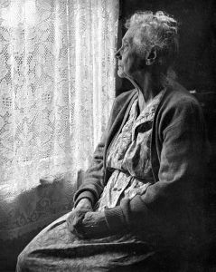 478px-Elderly_Woman_,_B&W_image_by_Chalmers_Butterfield via wikemedia smaller size